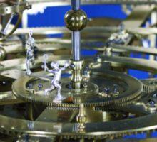 Golden metal cogwheels inside clockwork Sticker