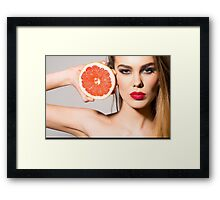 beautiful young girl with an orange in his hand Framed Print