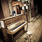 Antique Piano in Antique Market by Stanley Tjhie