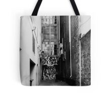 If I sit in this doorway, maybe no-one can see me ... Tote Bag