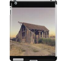 Rustic collapsing barn at sunset iPad Case/Skin