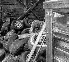 Tires thrown in a barn  by JULIENICOLEWEBB