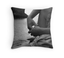 Strong hands on the coast Throw Pillow