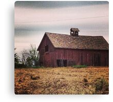 Rustic Red Barn Surrounded by Fields of Gold Canvas Print