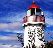 lighthouse at the maratime village by Ebony Jane
