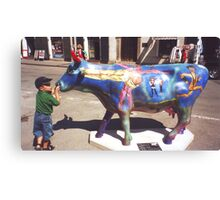 CONTEST: what does he say to the cow? Canvas Print