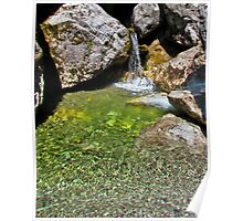 Small waterfall with a pool of water in the rocks Poster