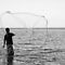 A Fisherman Casting Net by artz-one