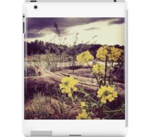 Fallen Log with Wildflowers Beside Riverbank iPad Case/Skin