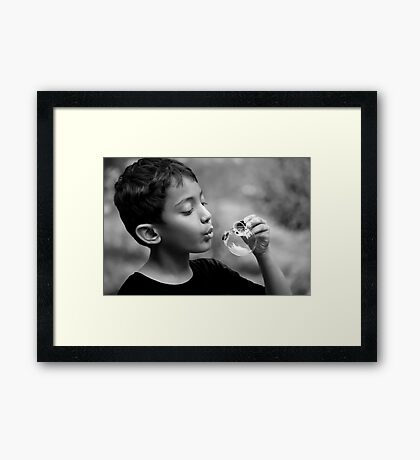 Blowing Bubble Framed Print