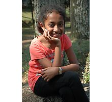 little girl sit down beside the tree Photographic Print