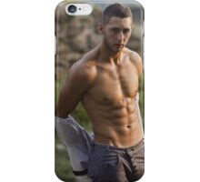 attractive athletic man with a naked torso takes off his shirt iPhone Case/Skin