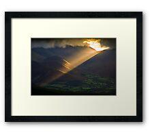 Golden rays on distant fells Framed Print