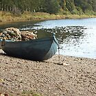 Boat on river bank by wjohnd
