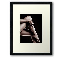 Closeup of Bare Woman Legs on Black Background art photo print Framed Print