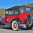 Red Model A Ford with white walls and yellow wire wheels by Ferenghi