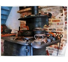Irons Heating On Stove Poster