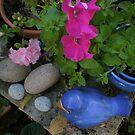Bluebird Hiding in the Garden by joycee