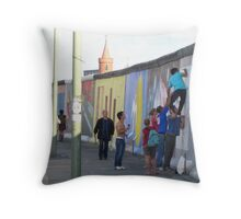 Adding a little piece to history, Eastside Gallery, Berlin, Germany June 2010.  Throw Pillow
