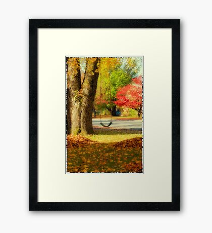 Swinging into Fall Framed Print