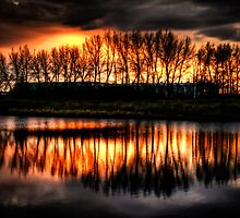 Sunset Over Stettler Pond by Myron Watamaniuk