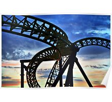 Coaster - Twisting frame of a roller coaster taken against a pastel sunrise Poster