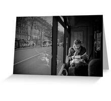 Reading in the bus Greeting Card