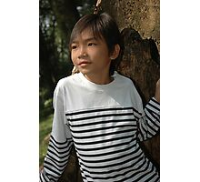 little boy stand up beside the tree Photographic Print
