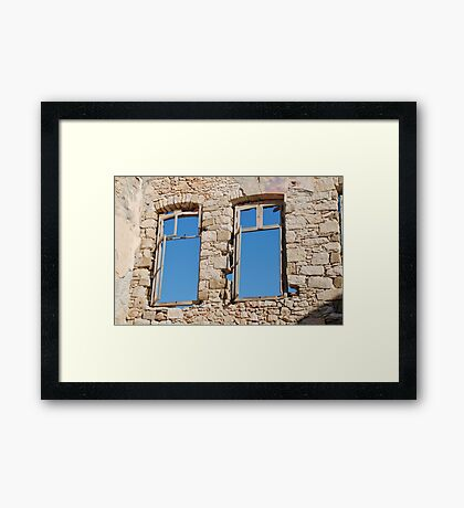 Old window on Halki Framed Print