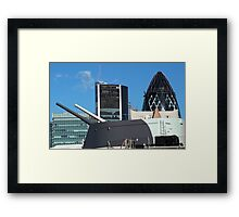 The guns of HMS Belfast with the City of London skyline behind Framed Print