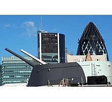 The guns of HMS Belfast with the City of London skyline behind Photographic Print