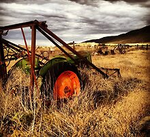 Abandoned Tractor in Fields of Gold, Waiting for the Storm by JULIENICOLEWEBB