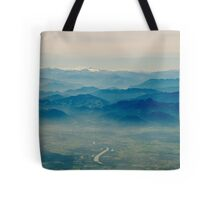 mountains in your memory appear closer than they are Tote Bag