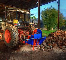 Tractor & the logs by Rob Hawkins