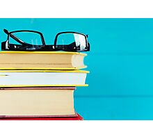 Black glasses and old books.  Photographic Print