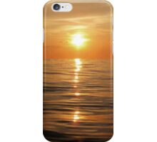 Sun setting over calm waters iPhone Case/Skin