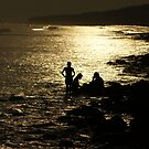Silhouetted people in conference against a golden sea by Shubhrajit Chatterjee