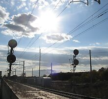 Doubled Train Traffic light signals in front of mansfield Commuter Rail's Station by Eric Sanford