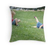 Children rolling down a hill Throw Pillow