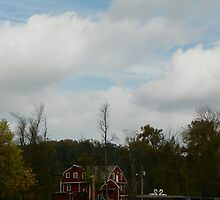 Clouds parting over War Eagle Mill an River by David  Hughes