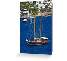 Sailing boat on blue water Greeting Card
