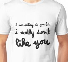 I am smiling at you but I really don't like you. T-Shirt