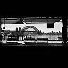 Sydney's Harbour Bridge from the train station (black and white) by Lainey Brown