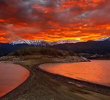 Sunset at Plastiras lake & Agrafa mountains. by Hercules Milas