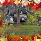A Log Cabin in Fall..... by Larry Llewellyn