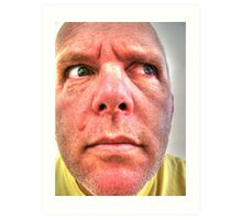 Man with angry, suspicious look on his face Art Print