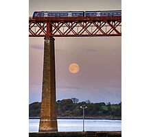 The train flew over the Moon Photographic Print