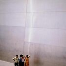 Indian family posing for photograph at the Saint Louis Arch by Timothy Wilkendorf