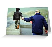 father and son walking by the beach. Greeting Card