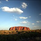 Uluru at sunset. by John Dalkin